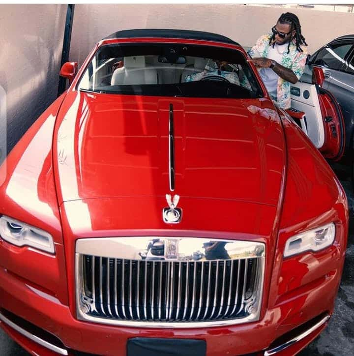Burna Boy, posses with his beautiful cars